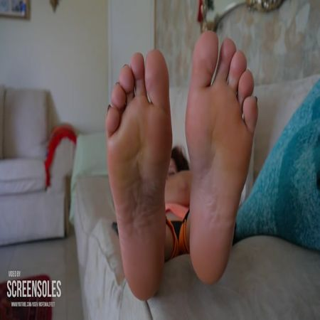 Nita's soles on the couch