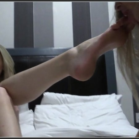 Beth gets down on Danielle's NYLON feet before the girls enjoy sucking on BARE toes, part 2