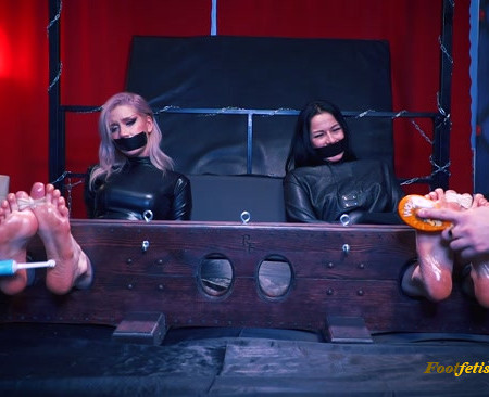 Klavdia, Taisia – Double tickling in big stocks in catsuit and straight jacket