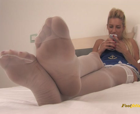 Pearl – If you're a fan of smelly stockings, Pearl will let you sniff her huge feet!