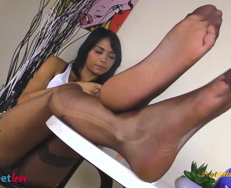 Nylon Feet Love – Sexy Felisja Fishball smoking while showing off her nylon-clad feet