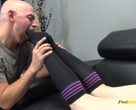 Shauna is ignoring her slave while he licks her sneakers and socks
