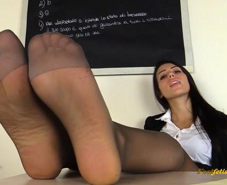 Teacher Petra having fun with her feet in the classroom